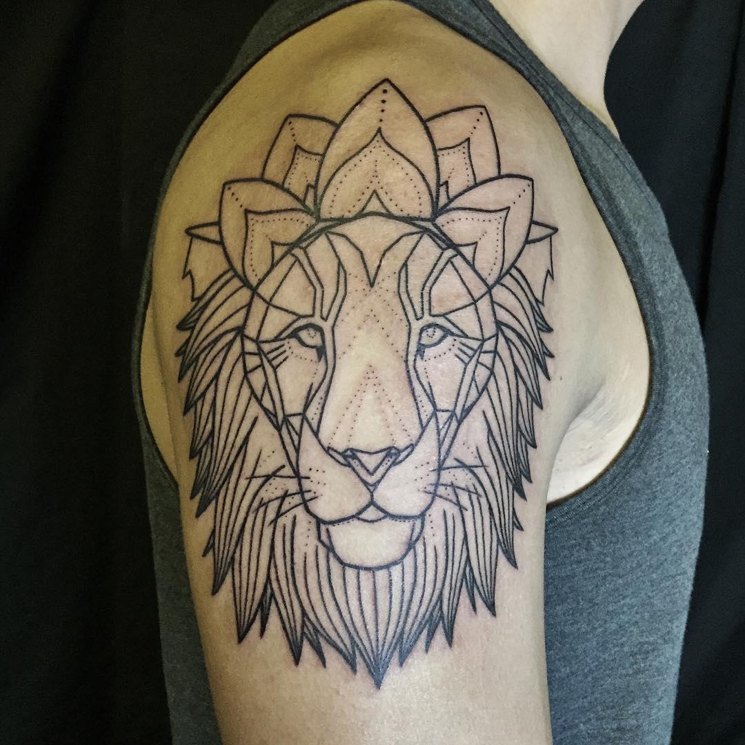 Traditional lion head tattoo