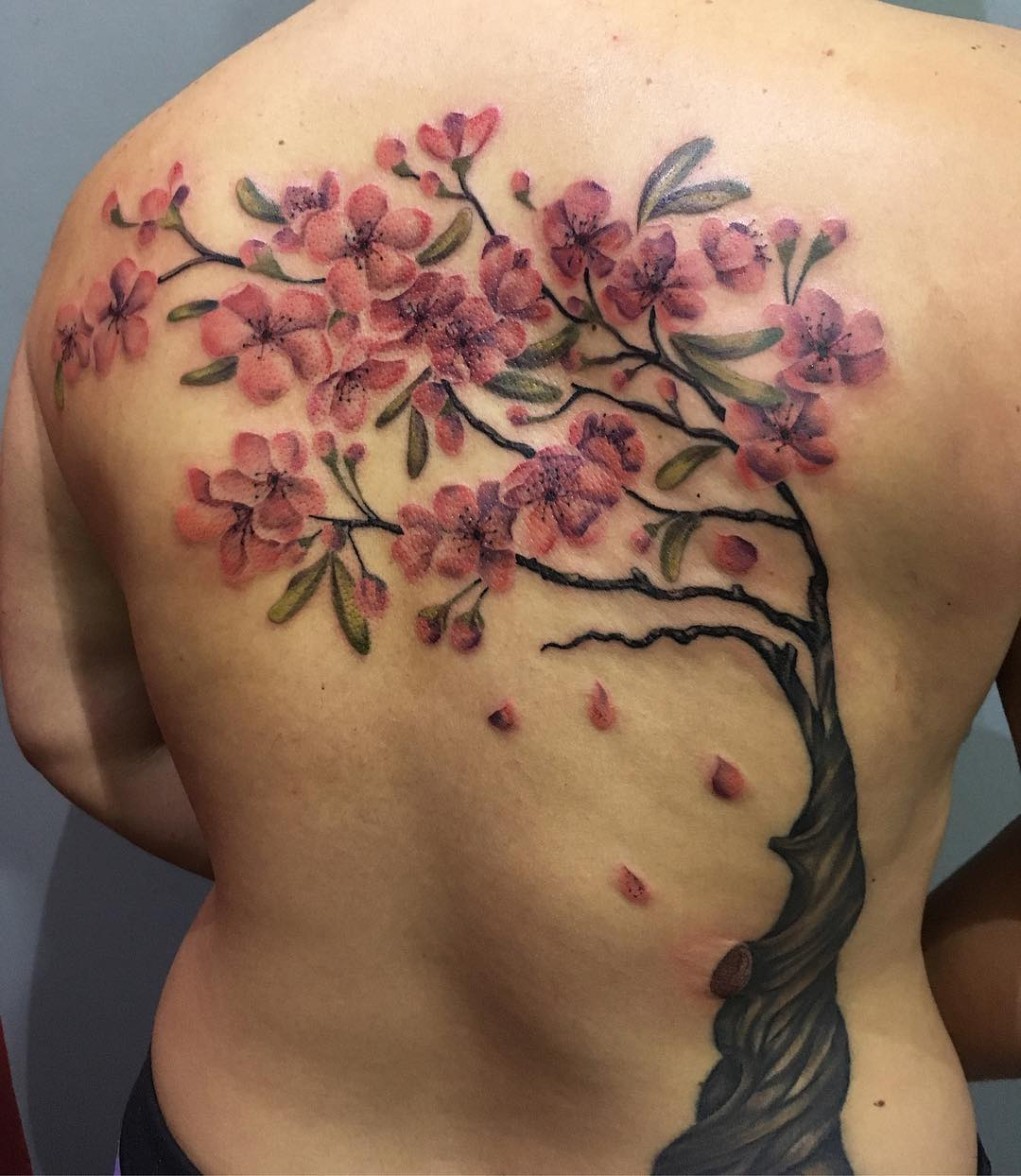 Feminine Cherry Blossom Tattoo Design