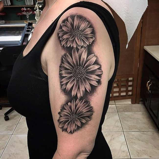 1cb73587d Contrary to what one might think this type of tattoo does not look dull at  al especially if an experienced artist draws it. Daisy Flower Tattoo 75