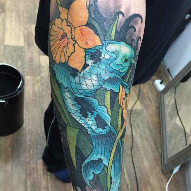 Yellow koi tattoo
