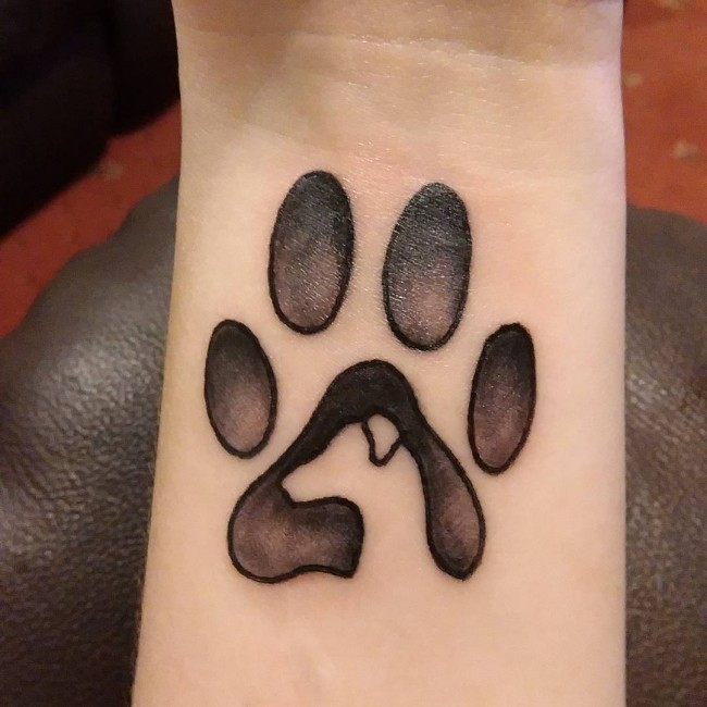 Paw print to make the tattoo more different form the cat paw tattoo