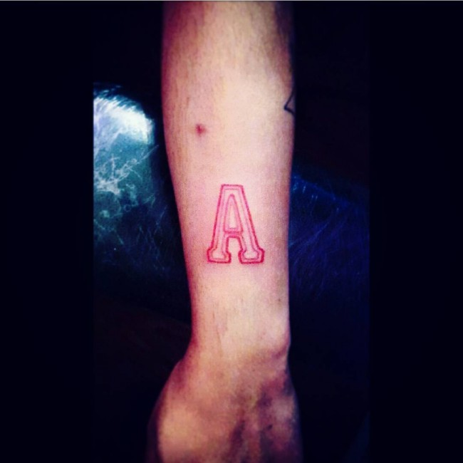initial tattoo 31