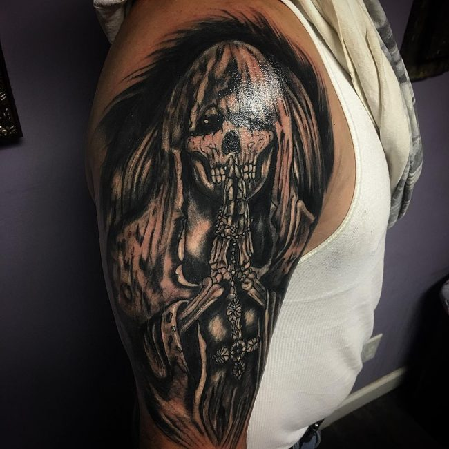 5c78cea846567 You can fit it perfectly on your leg as well. However, wherever you place  it, you cannot hide a grim reaper like other tattoo designs.
