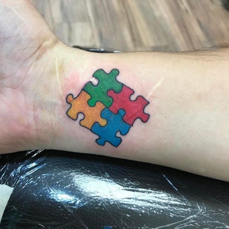 Puzzle Pieces Tattoo 70